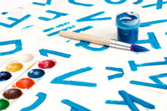 Alphabet drawing. Process of creating watercolor font. Royalty Free Stock Photo