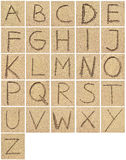 Alphabet drawing or writing in the sand. Arrangement of letters in the sand royalty free stock photography