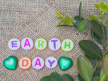 Alphabet Earth day word on sack background Stock Images