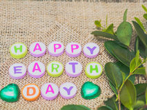 Alphabet Earth day word on sack background Stock Photo
