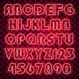 Alphabet et chiffres au néon rouges rougeoyants Images stock