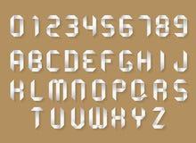 Alphabet et nombres de papier Images stock