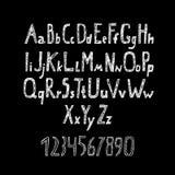 Alphabet et nombres dessinés par craie Photo stock
