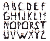 The Alphabet formed by humans. Group of black dressed people forming the alphabet royalty free stock photo