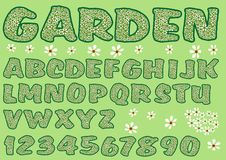 Alphabet in green garden design. Capital letters and numbers decorated with floral pattern, bold font. Royalty Free Stock Photo