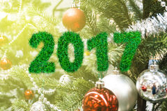 2017 Alphabet from the green grass on christmas ball with in pin Stock Photo