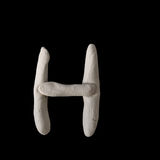 Alphabet H mold by clay on black Royalty Free Stock Photos