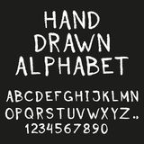 Alphabet. Hand drawn letters and numbers isolated on black background. Vector illustration. Alphabet. Hand drawn letters and numbers isolated on black stock illustration