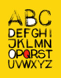 Alphabet. hand drawn in vector on yellow Stock Images