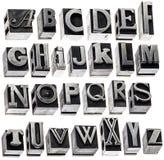 Alphabet im Weinlesemetalltypen Stockfotos