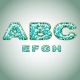 Alphabet imitating precious shiny surface Stock Image