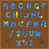 Alphabet in the Indian style. Funny blue yellow letters Stock Photo