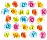 Alphabet joyeux dans des baisses colorées Photos libres de droits