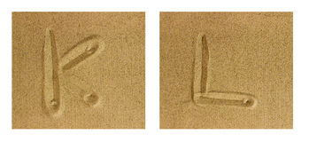 Alphabet K-L on sand Stock Photos