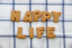 Alphabet-Kekse, fassen glückliches Leben ab Stockfoto