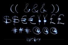 Alphabet léger de peinture - devises légères et autre de Serge Font Images libres de droits