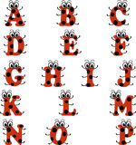 Alphabet in ladybug style, in red and black color royalty free stock photos
