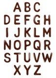 Alphabet latin élégant fait de chocolat fondu illustration libre de droits