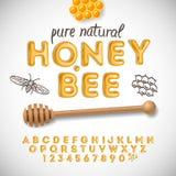 Alphabet latin et nombres faits de miel illustration stock