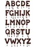 Alphabet latin fait de chocolat fondu avec des baisses illustration de vecteur