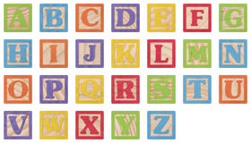 Alphabet Learning Blocks. Painted Uppercase Letters In Wooden Blocks Collection with clipping paths Royalty Free Stock Image