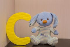 Alphabet letter C near rabbit bunny royalty free stock photos