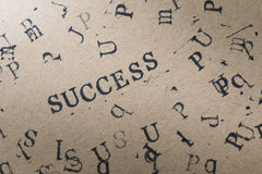 alphabet letter word success from stamp letters font on paper fo Royalty Free Stock Images