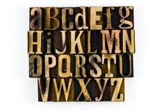 Alphabet letterpress wood isolated abc. Wooden blocks vintage letterpress words isolated white background education learning alphabet abc educational letters royalty free stock image