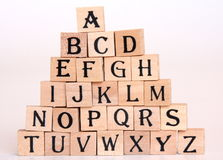 Alphabet letters. Alphabet made of small wooden letters stock photos