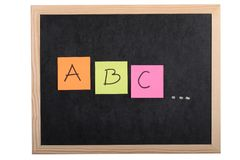 Alphabet letters on blackboard Stock Image