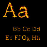 Alphabet letters in fire flames 1. A b c d e f g h alphabet letters in fire flames on dark background Royalty Free Stock Photography