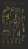 Alphabet letters lowercase, uppercase and numbers gold on black. Stock Photography