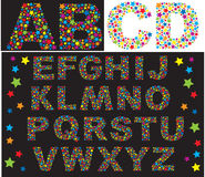 Alphabet - letters are made of multicolored stars. Alphabet - letters are made of multicolored rainbow stars Stock Images