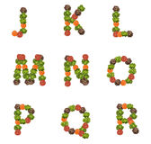 Alphabet letters made from vegetables. Tomato salad and carot Stock Photos
