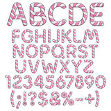 Alphabet, letters, numbers and signs from pink and white sweets. Stock Photos