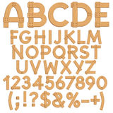 Alphabet, letters, numbers and signs from wooden boards. Royalty Free Stock Photos