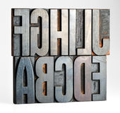 Alphabet letters on old printers blocks Stock Photography