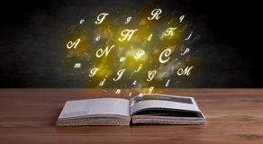 Alphabet letters over book Royalty Free Stock Images