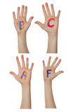 Alphabet (letters) painted on children hands. Rises up hands. Alphabet (letters) painted on children hands. Rises up hands stock photos