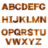 Alphabet - letters from rusty metal with rivets. Isolated over white Royalty Free Stock Photo