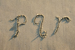 Alphabet letters in sand on beach Royalty Free Stock Photos