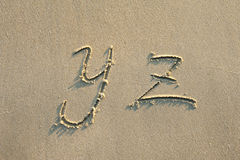 Alphabet letters in sand on beach Stock Image