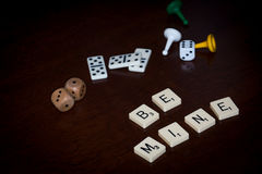 Alphabet letters spell out `BE MINE` stock photos