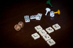 Alphabet letters spell out `LIVE LIFE` Stock Photos