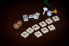 Alphabet letters spell out `NUMBER ONE` royalty free stock image