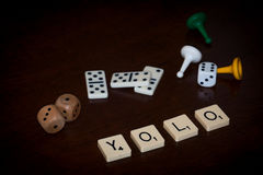 Alphabet letters spell out `YOLO` royalty free stock photography