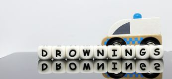 Alphabet letters spelling a word drownings. A condition demands urgent medical treatment Stock Image