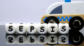 Alphabet letters spelling a word sepsis. A condition demands urgent medical treatment Stock Photos