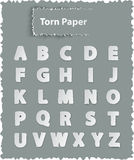 Alphabet letters on torn paper Stock Photos
