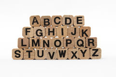 Alphabet letters on wooden cubes, isolated on white Royalty Free Stock Photo